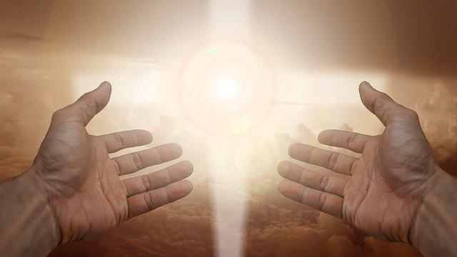 十字の光と手